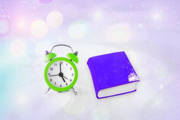 time to read book and vintage alarm clock