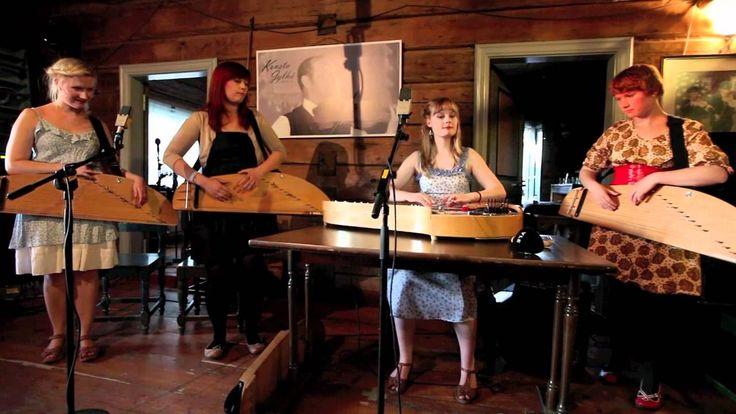 Finnish folk music group Kardemimmit singing Tuonen tyttö and playing on ancient Finnish harps, the kantele.