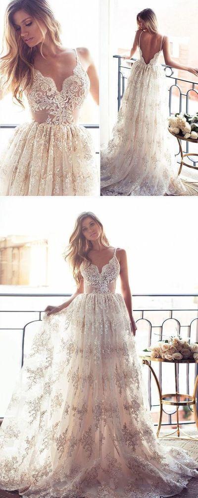 Bellissimo abito con scollo a V, spalline sottili e un lungo abito da sposa # …