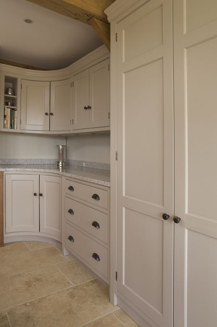 "Hand-painted kitchen cabinetry in Farrow & Ball ""Elephant's Breath""."