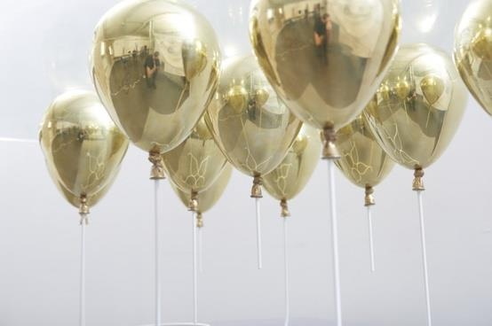 combine with hula hoop chandelier with marbles to make them hang down. metallic colored balloons!