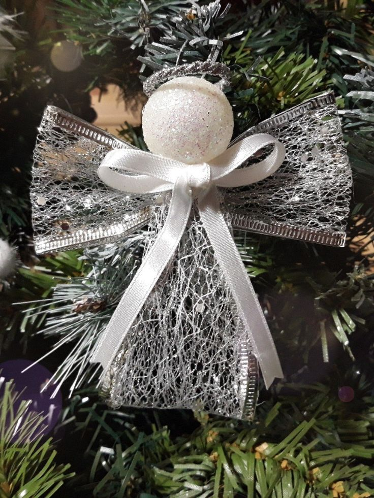 DIY Angel Christmas tree ornament, with silver ribbon and small white glitter ball.