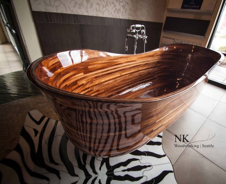This wood bathtub offers you the luxury of fine art furniture as the centerpiece of your bathroom. Not to mention an unparalleled soak. This piece can be the wooden's touch that you are looking for your luxury bathroom. 10 Fabulous Wooden Luxury Bathroom Ideas to Inspire You ➤To see more Luxury Bathroom ideas visit us at www.luxurybathrooms.eu #luxurybathrooms #homedecorideas #bathroomideas @BathroomsLuxury