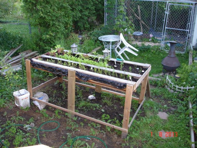 Finished raised pallet garden pallet and skid diy for Gardening using pallets