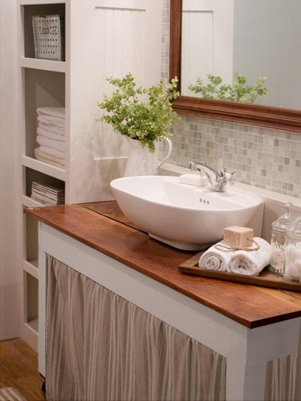 Cottage Style Bath: Simple off-white vanity with wood countertop and skirt, vessel sink, open shelves