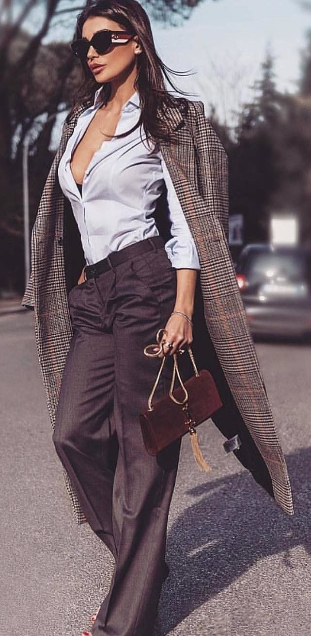 #spring #outfits shallow focus photography of woman standing on asphalt road. Pic by @london_fashion_and_style