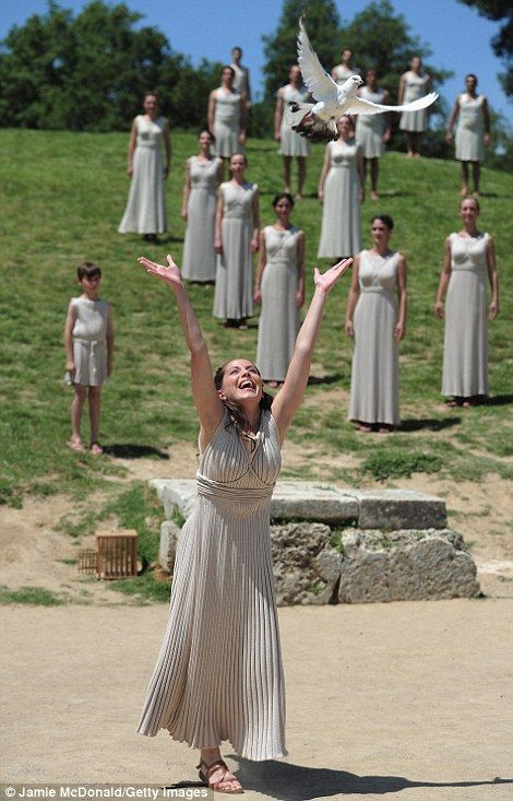 A priestess releases a dove during the Ancient Olympia rehearsal ceremony.