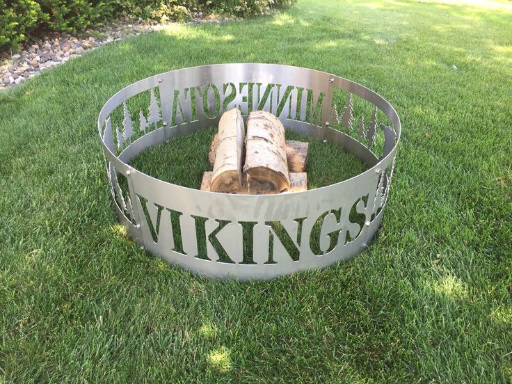 Our 4 piece Stainless Steel bolt together Minnesota Vikings fire ring showcases the state of MN with pine trees on 2 sides with the words Minnesota on one side and Vikings on the other. Please note we