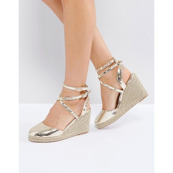 ASOS JEKYLL Studded Espadrille Wedges ($36) ❤ liked on Polyvore featuring shoes, sandals, gold, studded sandals, espadrille wedge sandals, studded wedge sandals, gold prom shoes and wedge espadrilles