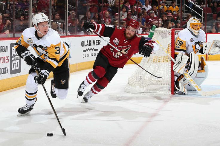 Coyotes vs. Penguins - 02/11/2017 - Pittsburgh Penguins - Photos  Olli Maatta #3 of the Pittsburgh Penguins skates with the puck ahead of Max Domi #16
