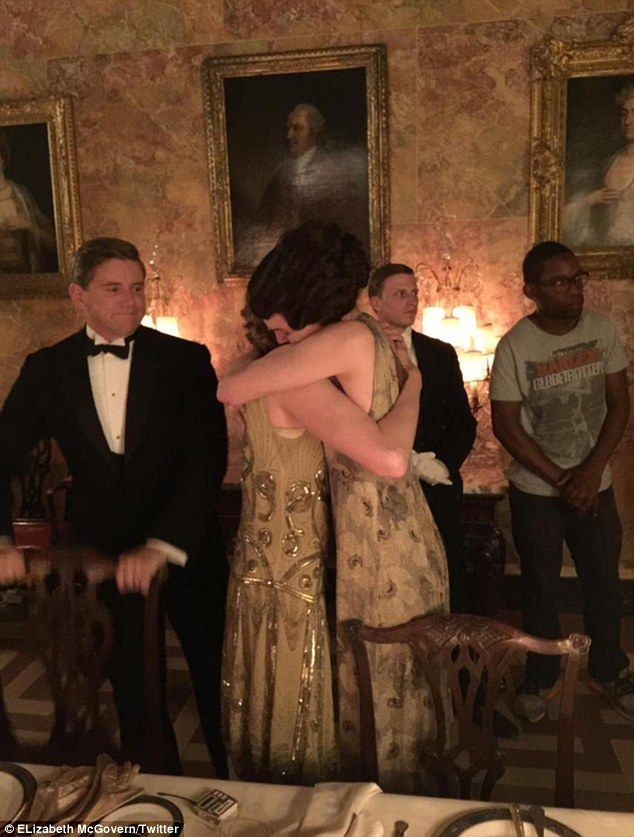 So sad to say goodbye: Elizabeth McGovern hugs one of her female co-stars - believed to be Laura Carmichael - as Allen Leech looks on