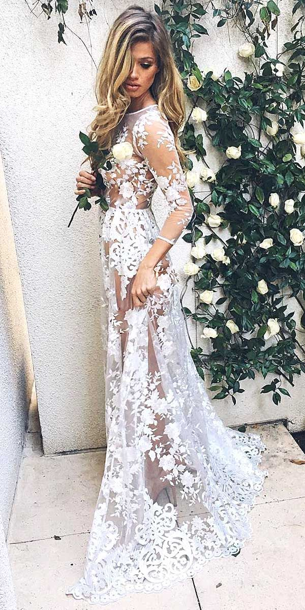 We adore this long sleeve lace wedding dress.