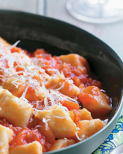 Gnocchi with fresh tomato and basil sauce. Be sure to use perfectly vine-ripened tomatoes to make this dish extra special. Recipe from the book, Poh's Kitchen (HarperCollins)