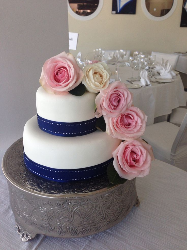 2 tier white wedding cake with roses