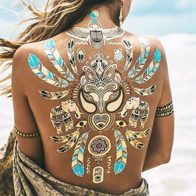 Isn't this awesome? Metallic tattoos perfect for those beach day by lilanikole
