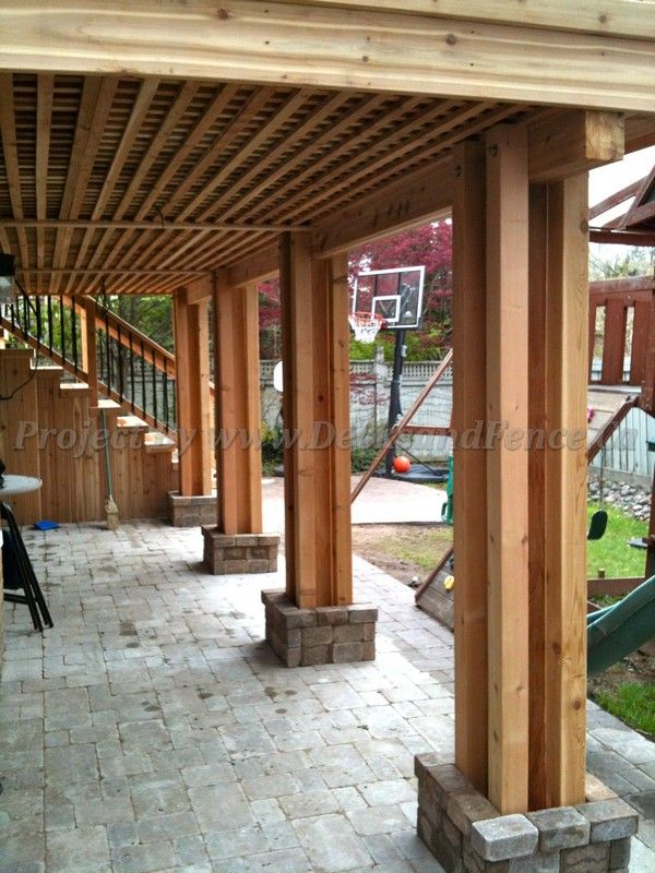 Basement exit interlock with 2nd level deck - Toronto decks design & deck building company, PVC, Azek and Cedar