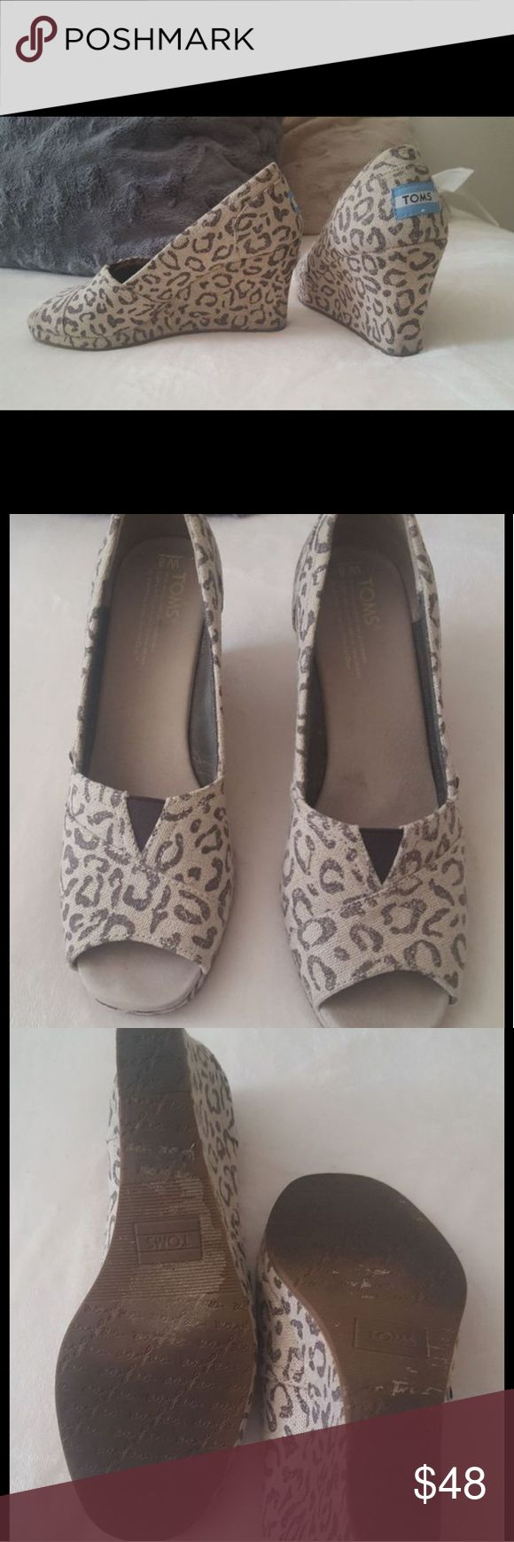 TOMS Snow Leopard wedges Excellent condition. Really comfortable. Inside of shoe is clean. Open toe. Almost no signs of wear besides the bottoms. Size 8. Toms Shoes Wedges
