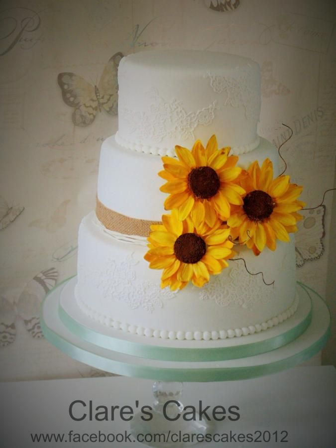 Sunflower Wedding Cake- love the lace details. No curly string things hanging out though..