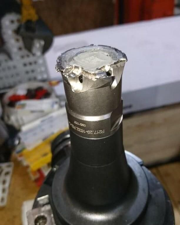 """Here's another CNC crash from @nymanolof. Someone thought the endmill ran better without coolant. """"Back from parental leave and greeted by this welded stuck piece of highspeed mill! """"same procedure as last year"""", but a bit more expensive!!"""" Ouch - Machinist Life"""