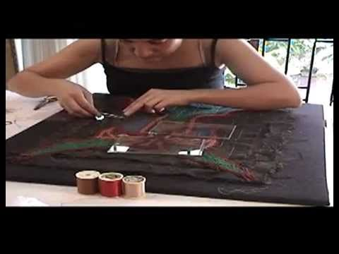 Restauración Arpillera Violeta Parra