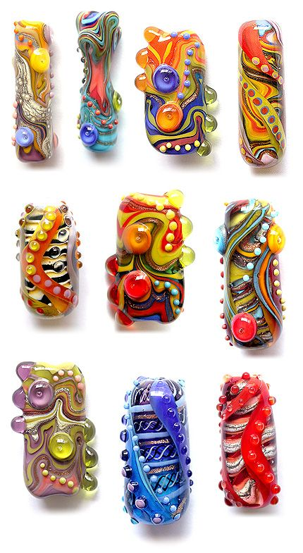 These are totally wacky and fun. I love it when people take a basic idea or set of elements and then do a series of beads based on the same theme... I think it's a great way to push your skills, and also great for those days when the creativity is not flowing as freely as it usually does. Focal beads by Sarah Hornik. #lampwork