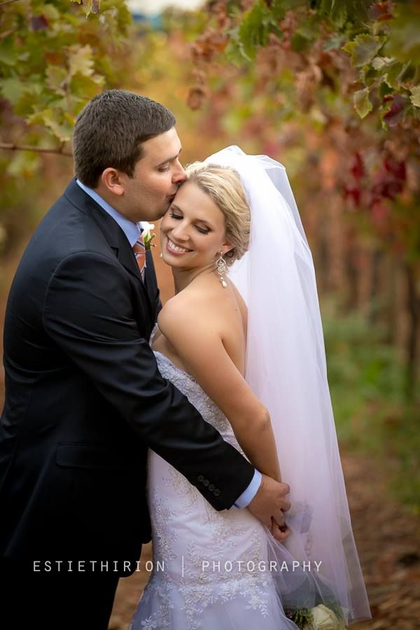Bride and groom having their moment in our vineyards during autumn