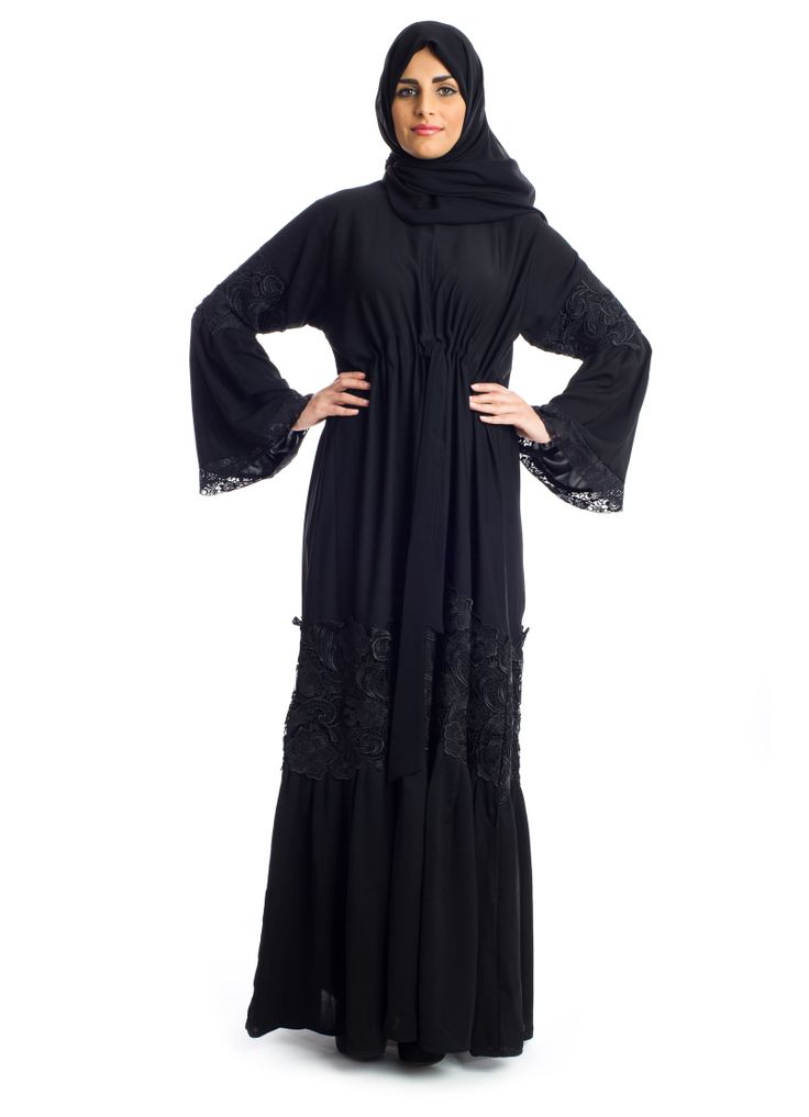 For that added touch of uniqueness to your traditional look, Abaya from Xela makes a great buy. It features a flowy Abaya from the finest Neda fabric complimented with a stand-up neckline and details along the lower body & the sleeves. An evening look that adds a touch of sophistication to every woman!