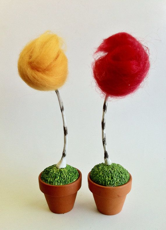 I made these Truffula Tree models out of Polymer clay, wool, and actual tiny flower pots.