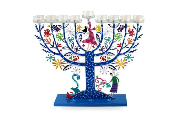 """A gift that declares """"The sky is the limit!"""" Description: This lively colorful Menorah reflects Tzuki's zest for life. The soothing essence of blue blends with the spiritual aspirations of his Menorah family. Mother and daughter work in unison and harmony. Responding to their devoted care, the tree grows a lush selection of leaves and flowers. The cats on the side purr in delight. The different shades of dots on the tree symbolize the rich variety of life. Happy Chanukah!  Materials: metal…"""