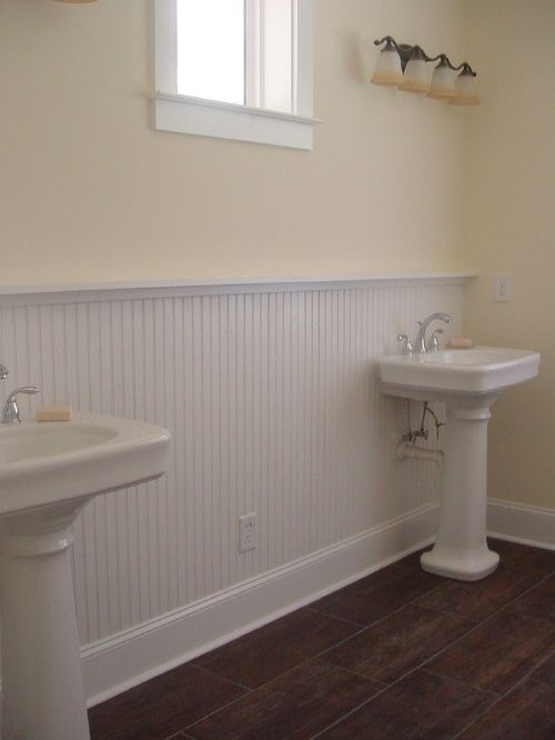woodlook tile floor white beadboard pale creamy yellow walls