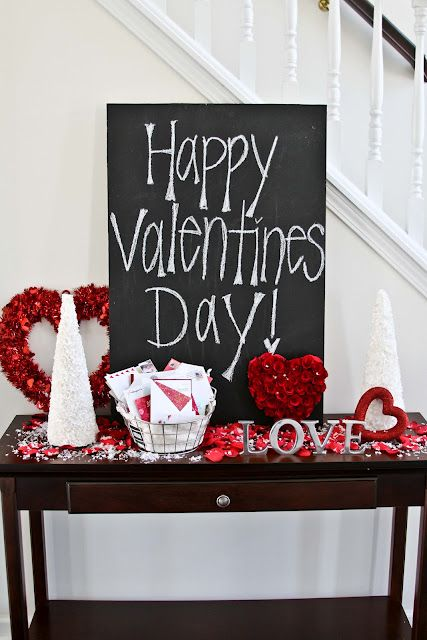 Valentines Day decor - front entry way... I like the chalk board,