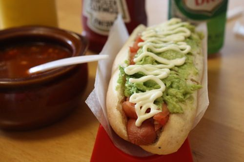 Completo - Chilean hot dog... It's a huge hot dog on an Italian roll, usually topped with avocado, tomatoes, and mayo. However, there are so many variations available.
