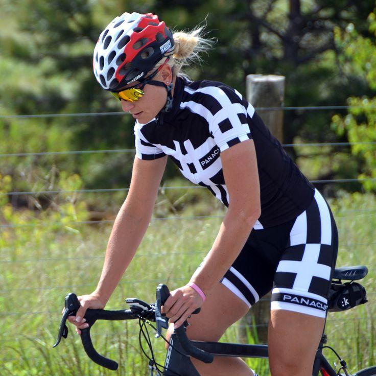Woman cyclist wearing Panache Viking Cycling jersey and bib shorts.
