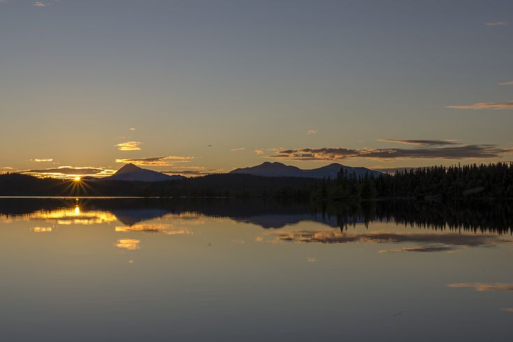 Sunset over a calm lake in Northern Sweden.