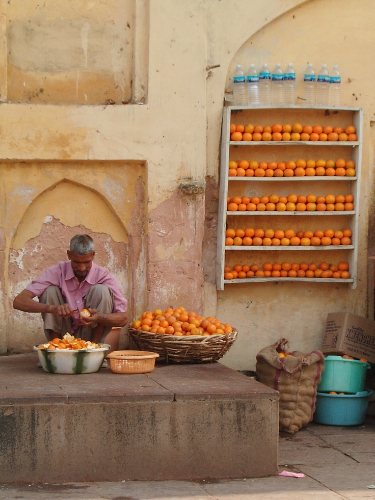 Warm colors with a cool accent - Orange seller, India