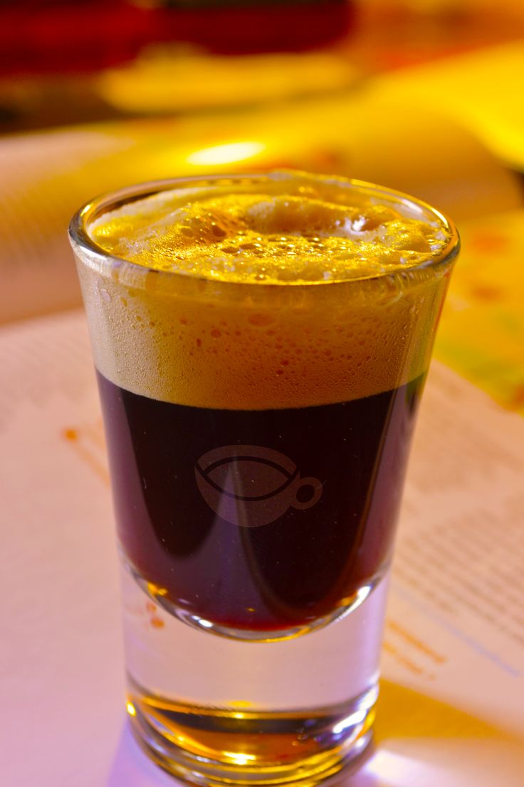 Espresso shot in transparent glass with foam. Copyright © OfficeCaffe 2013. All rights reserved