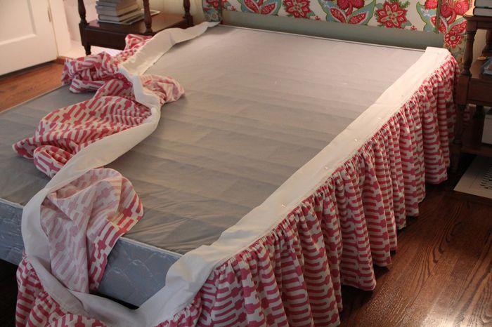 Instead of making a fabric deck to cover the entire box spring, I attached the gathered fabric to a strip of cotton. This makes maneuvering all that fabric much easier and less swear-inducing. It's also super easy to attach to the box spring. The secret? Twisted upholstery pins.