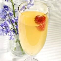 A good baby-shower punch made with ginger ale, pineapple juice and white grape juice. It looks especially good when served with an ice ring.