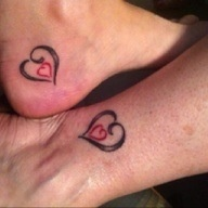 Mother daughter tattoo this is simple but maybe intertwine two smaller hearts on either side of the black one. The left towards the top the right towards the bottom?