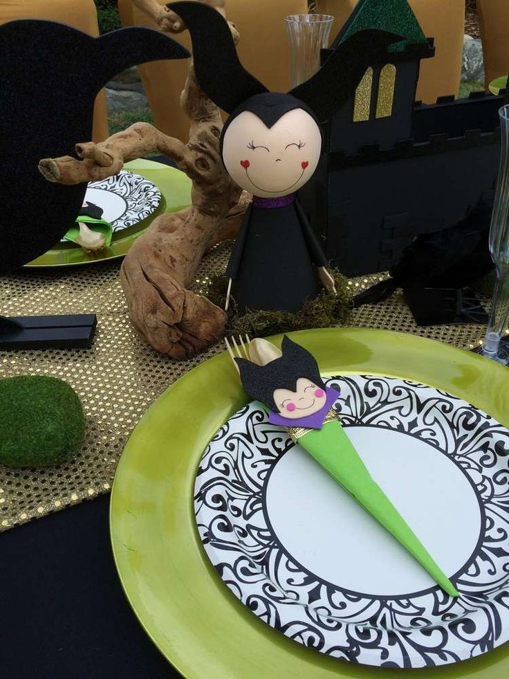 Fun place settings at a Maleficent & Aurora birthday party! See more party planning ideas at CatchMyParty.com!