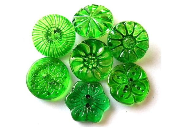 7 Vintage Czech glass buttons, 7 flowers and floral designs hand painted in green. $8.00, via Etsy.