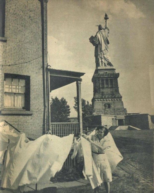 'Over the years, people have lived in Lady Liberty's backyard. Chores still needed to be done…..here a woman hangs laundry probably during later years when the War Department was Lady Liberty's caretaker.