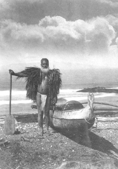 Hawaiian fisherman in a malo and 'ahu lā'ī, Mauna Kea in background; Hawai'i. ca. 1900.