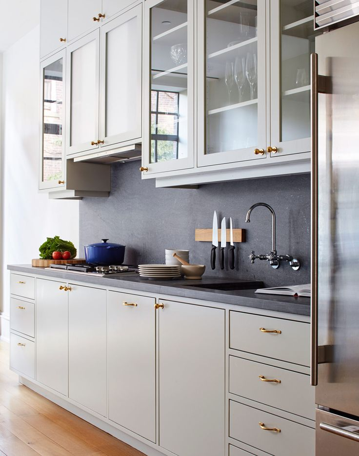 brooklyn townhouse kitchen with warm white cabinets and grey countertop and backsplash   via coco kelley