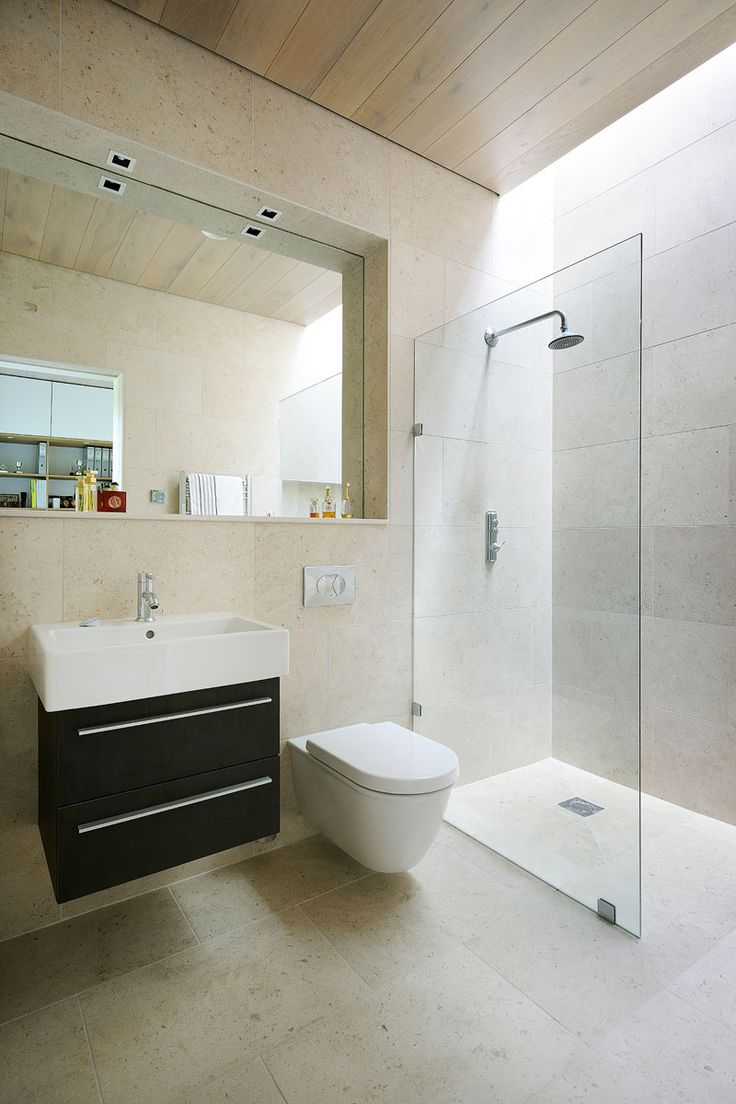 In this bathroom, the mirror is set back, providing space for a ledge, perfect…