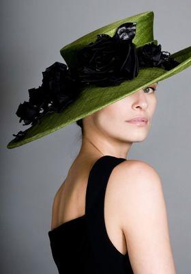 Green asymmetric sidesweep with hand made black taffeta roses - Rachel Trevor Morgan
