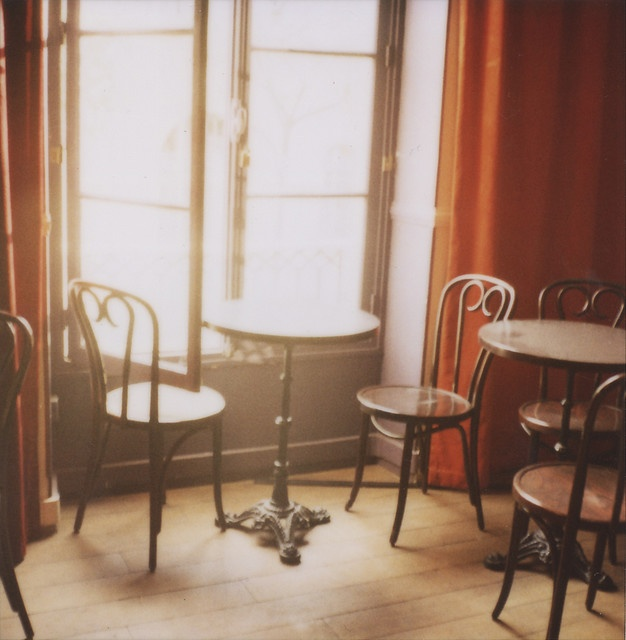Paris cafe photograph. I want my dining chairs to look like they came from a Parisian cafe