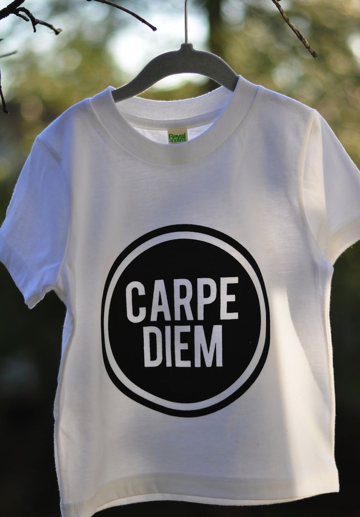 "Hand printed on Royal Apparel Organic Kids Fine Jersey Short Sleeve Tee using eco-friendly, water based inks. $1.00 (cad) for every ""Carpe Diem"" shirt sold will be donated to the ""Kid's Help Phone"" organization.'"