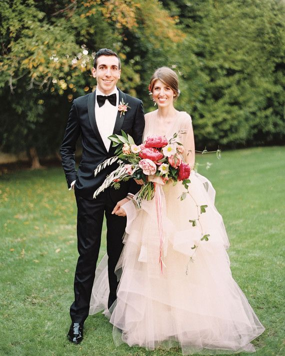 """Pink is my favorite color, and the venue was already dripping with fuchsia bougainvillea,"" says Kelly Lanza of her day's signature hue. ""Shades of pink seemed such a perfect fit—we just had to go for it."" Her groom, photographer Jeff Mindell, agreed. ""He's not afraid to embrace the pink,"" she says. And go for it they did, with corals, salmons, peaches, and berry tones on eye-catching display during their garden-chic wedding on November 15, 2014, at a sprawling estate in Palm Springs called…"