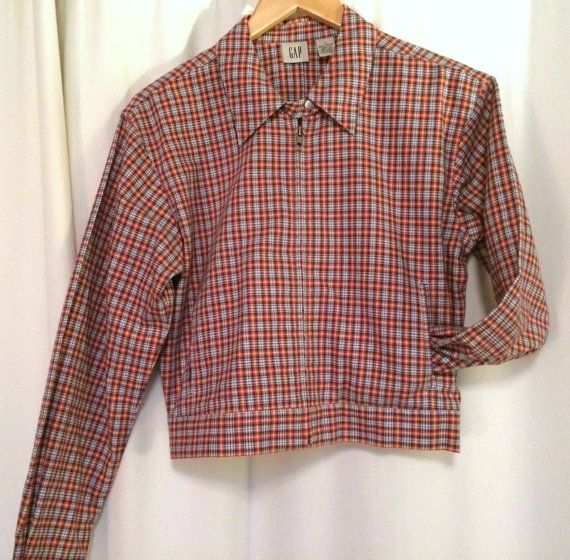 Great quality vintage Gap zip-up plaid womens shirt/jacket, size small. Red, blue, yellow, white. Two slit pockets on front, good quality zipper, and snap at collar bottom. Sort of a cross between a golf jacket, cafe style racer jacket, and resort wear. Not quite crop length, but short. Clean lines. Not fitted/no darts. Very cool looking. Made in Hong Kong.  Tagged size small, actual measurements are: Length (top of shoulder to bottom): 20 Chest (under arm to under arm): 20 (40 all ...